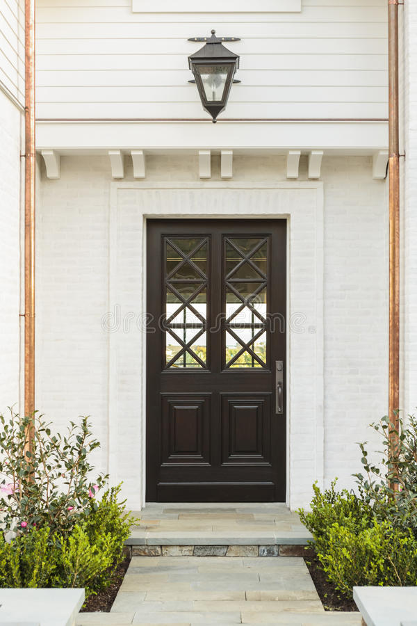 Detailed Wooden Front Door Of White Brick Home Stock Image - Image ...