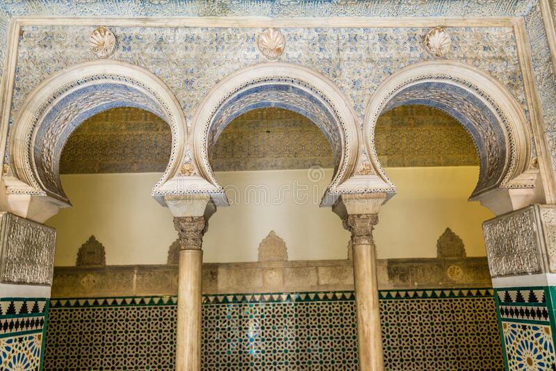 Detailes of an ornate tiled arch in Real Alcazar stock photos