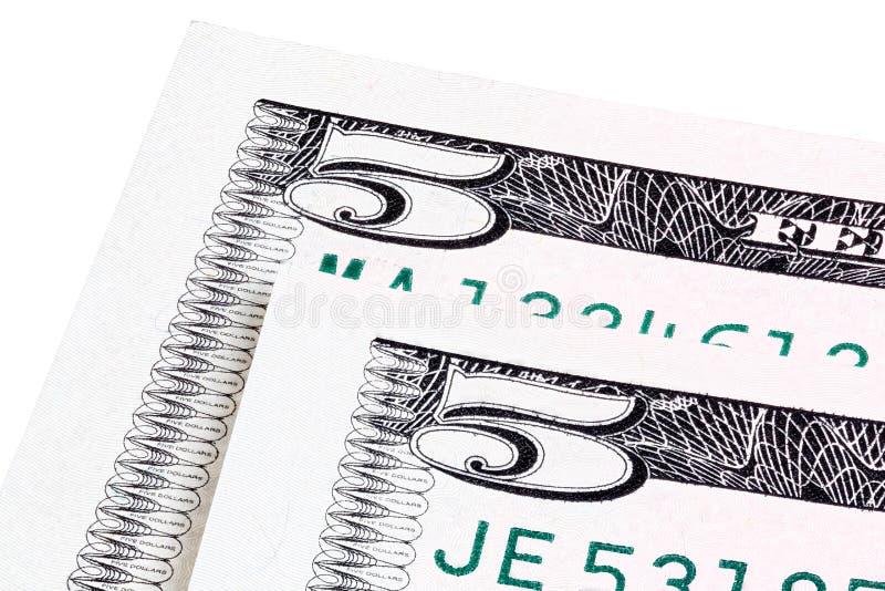 Detailfoto von zwei U S Fünfdollarschein, lokalisiert auf weißem, Staplungsfoto stockfotografie