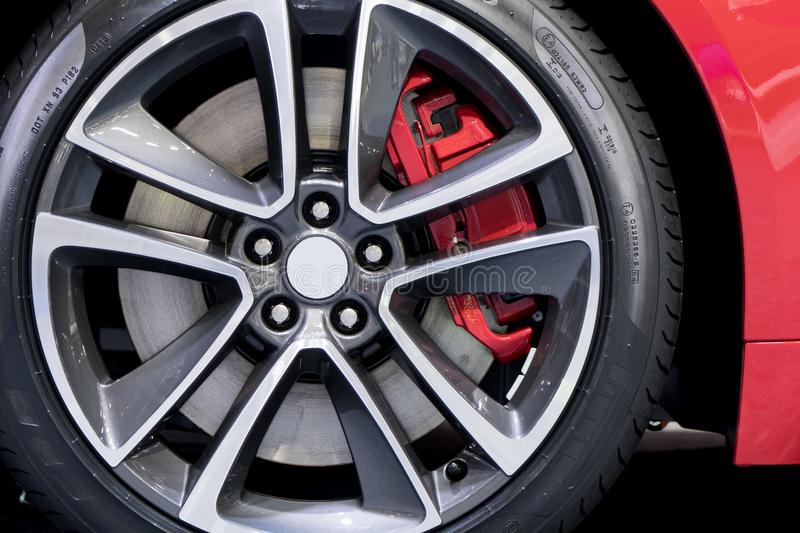 Detailing series. Clean super car disc-brake. Red rims from sports car.. royalty free stock image