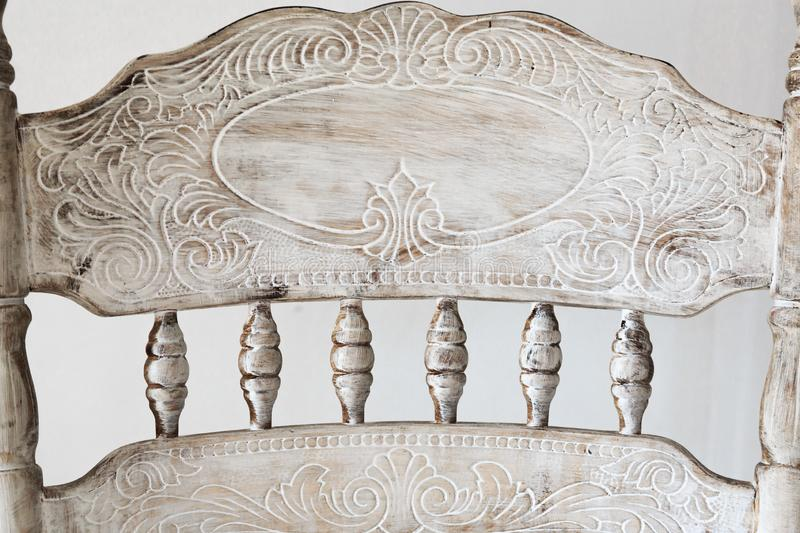 Details of ancient carved chair stock photography