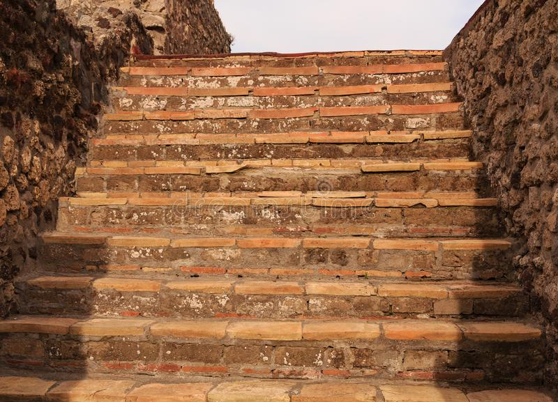 Ancient Stone Steps in Pompeii. Details of the Ancient city of Pompeii destroyed by volcano of Vesuvius royalty free stock images