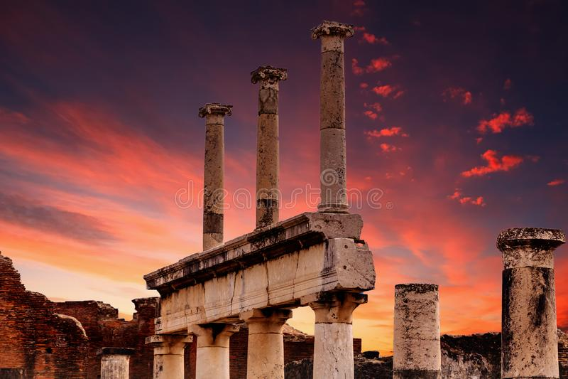 Sunset in Pompeii. Details of the Ancient city of Pompeii destroyed by volcano of Vesuvius royalty free stock photo