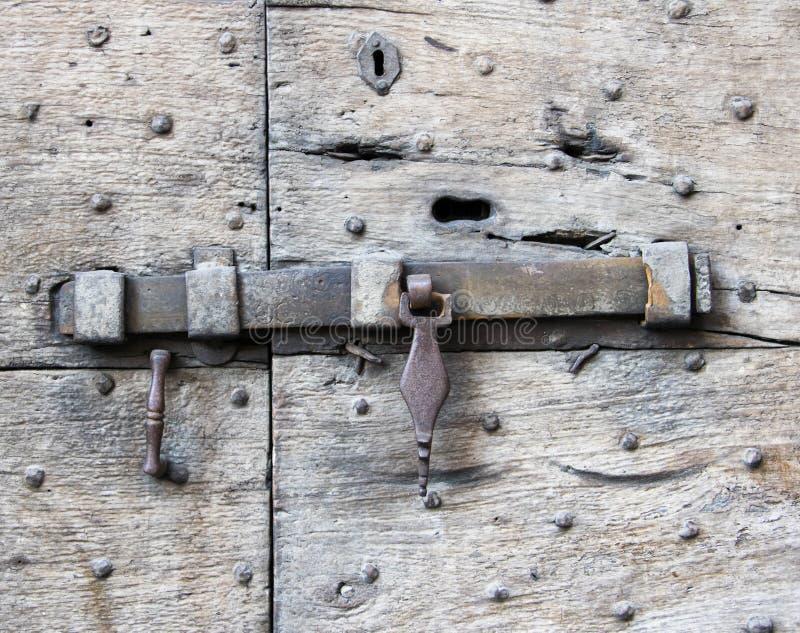 Details of an ancient Italian door. Details of an ancient Italian door in Florence, Italy stock images