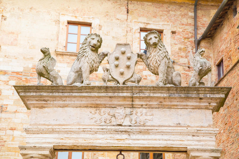 Details of ancient well of griffins and lions. Holding symbol of Medici family, Montepulciano, Tuscany, Italy royalty free stock photos