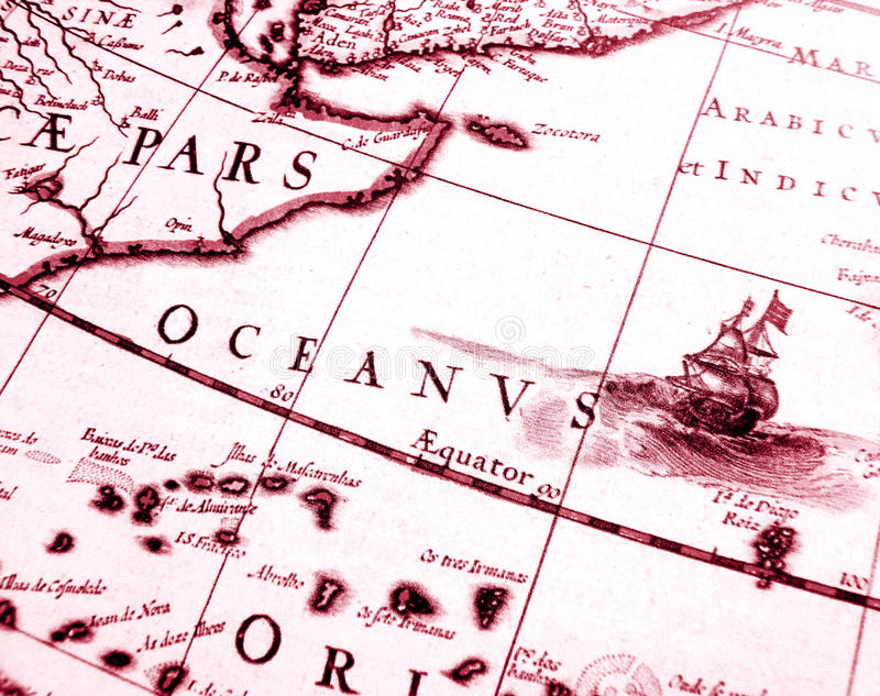 Details on antique sailing chart. A monochrome photograph of an old sailing ship details on an antique sailing navigation chart of Africa at the equator. Concept royalty free stock photo