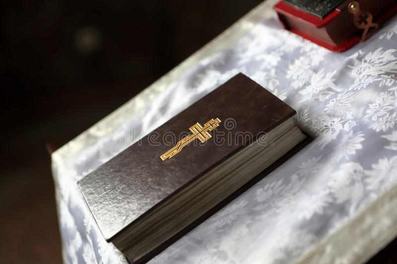 Details of bible on the pulpit. In an orthodox church stock photography
