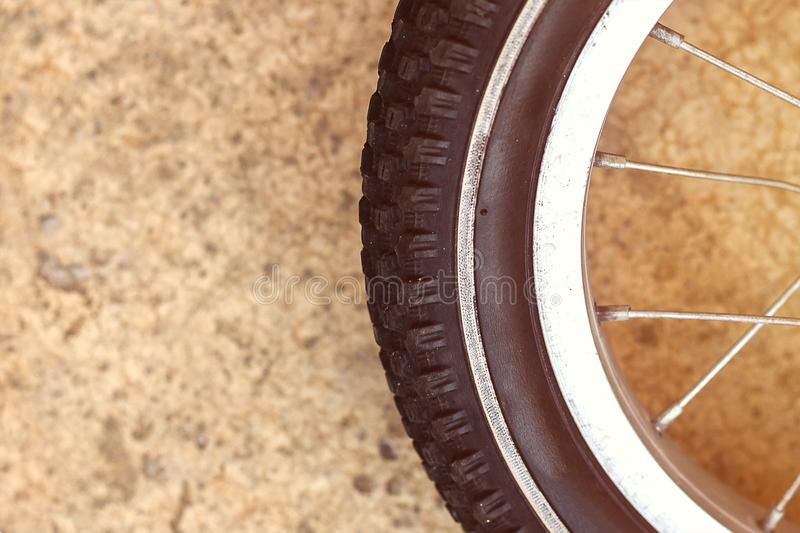 Details bike front wheel. Close-up view of kids bicycle wheel. Bicycle wheel and tire close up. front wheel of road bike royalty free stock photography
