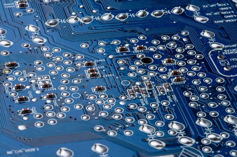 Details of a blue printed circuit board stock photo