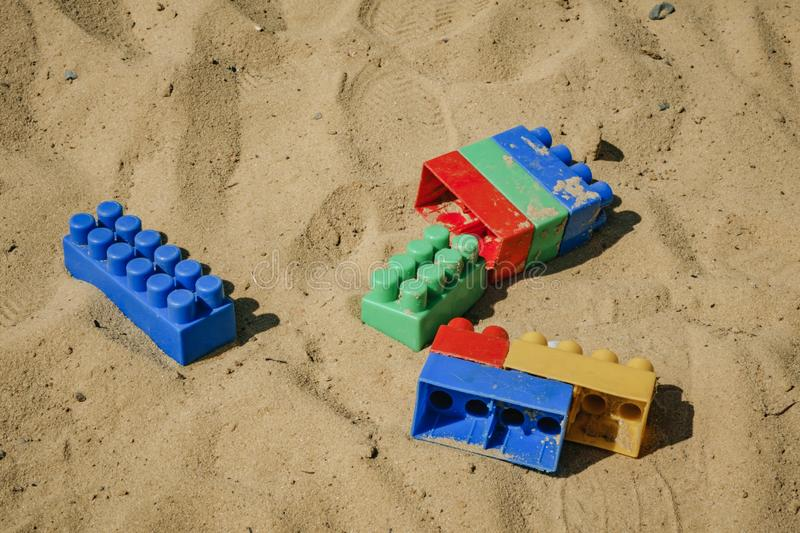 Details of the children& x27;s designer of different colors on the sand royalty free stock image