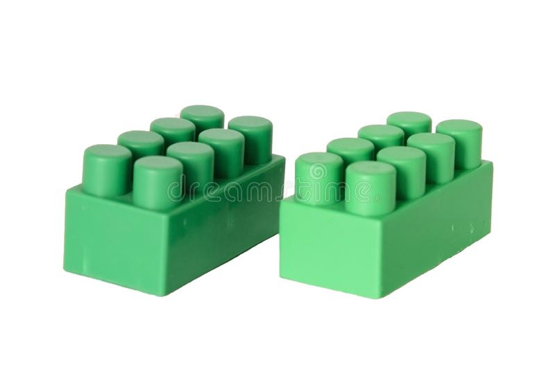 Details of a children& x27;s plastic constructor on a white background. colored cubes. block. Pictured in the photo details of a children& x27;s plastic stock photography