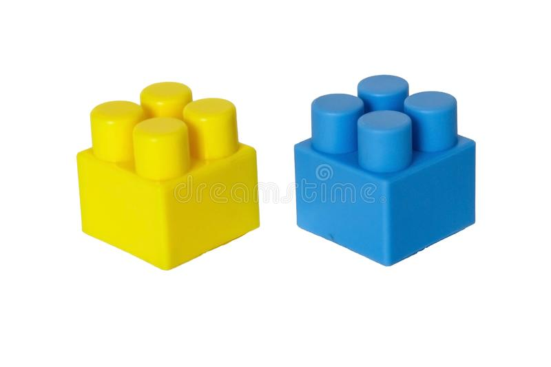 Details of a children& x27;s plastic constructor on a white background. colored cubes. building. Block stock photography