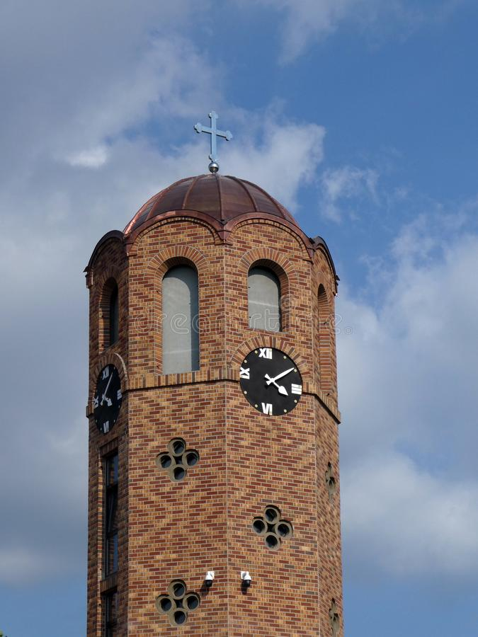 Details of the Church   tower with clock - The Orthodox Church of Nativiti of St John the royalty free stock image
