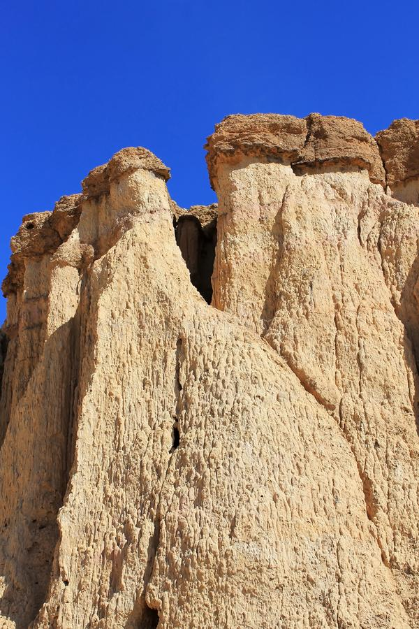 Details of the coloured cliffs in Tsagaan Suvraga in the Gobi desert, Dundgovi Province, Mongolia. Vertical view. Details of the beautifully coloured cliffs of stock photography