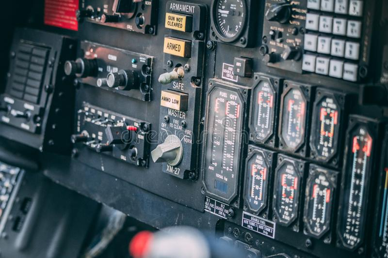 Details of control panel in military helicopter cockpit. Altitude and other major instruments on the panel of a military cockpit. Black metal frames and glowing royalty free stock photos