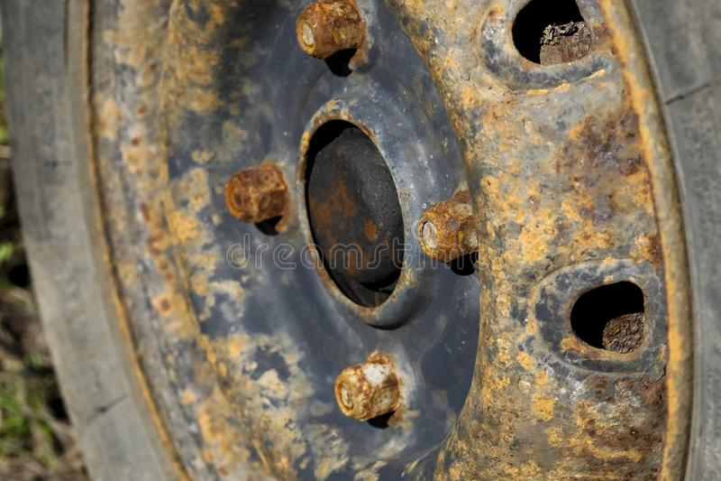 Details of the corroded steel rim. The old steel rim of an abandoned car is highly corroded royalty free stock photo