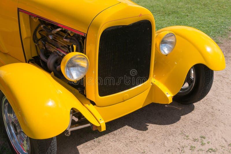 Classic yellow street rod. Details of a custom street rod royalty free stock photo
