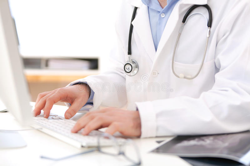 Details of doctor hands typing on keyboard stock photos