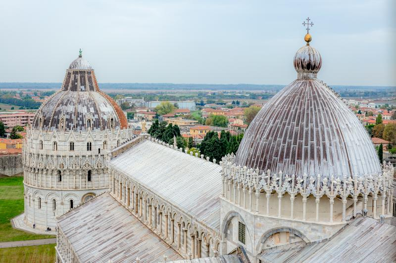 Details of the dome and roof of the carthedral of Pisa in a Autumn day - 4 royalty free stock images