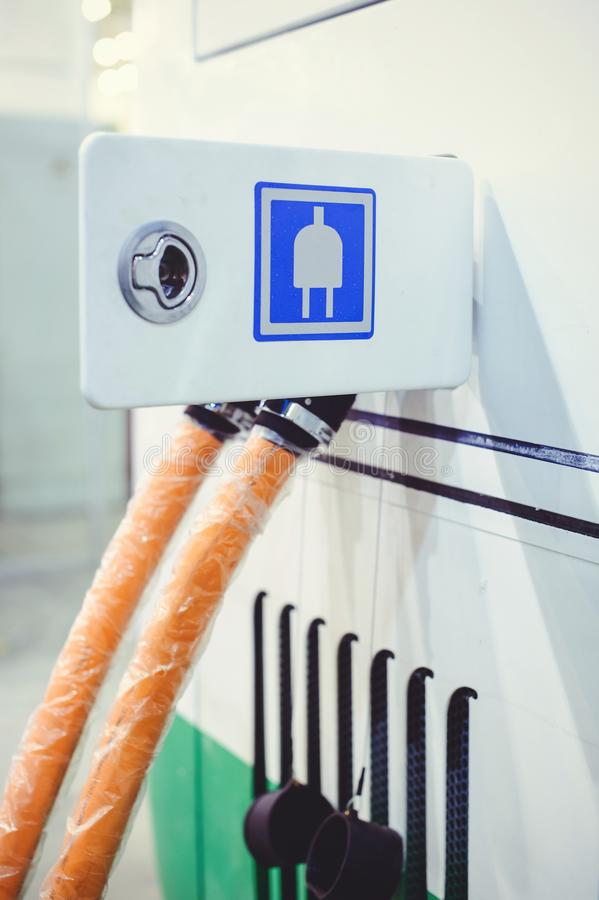 Details of electric vehicle charging city bus transport. Green and renewable energy sources.  stock images