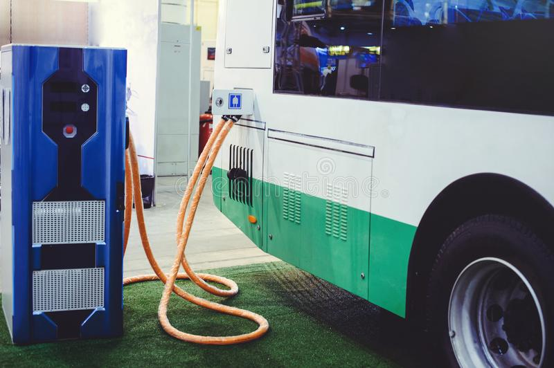 Details of electric vehicle charging city bus transport. Green and renewable energy sources.  stock photography