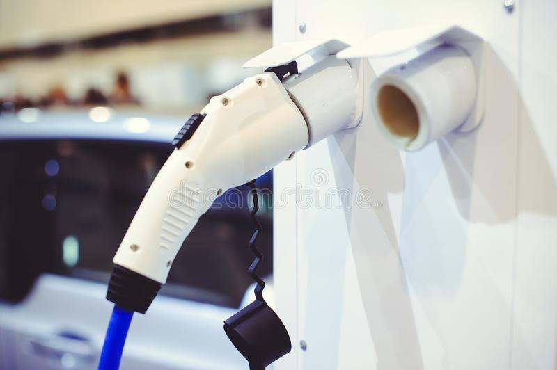 Details of electric vehicle charging. Green and renewable energy sources.  stock photo