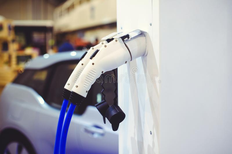 Details of electric vehicle charging. Green and renewable energy sources.  royalty free stock photography