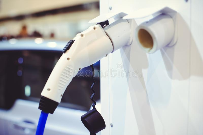 Details of electric vehicle charging. Green and renewable energy sources.  stock photography