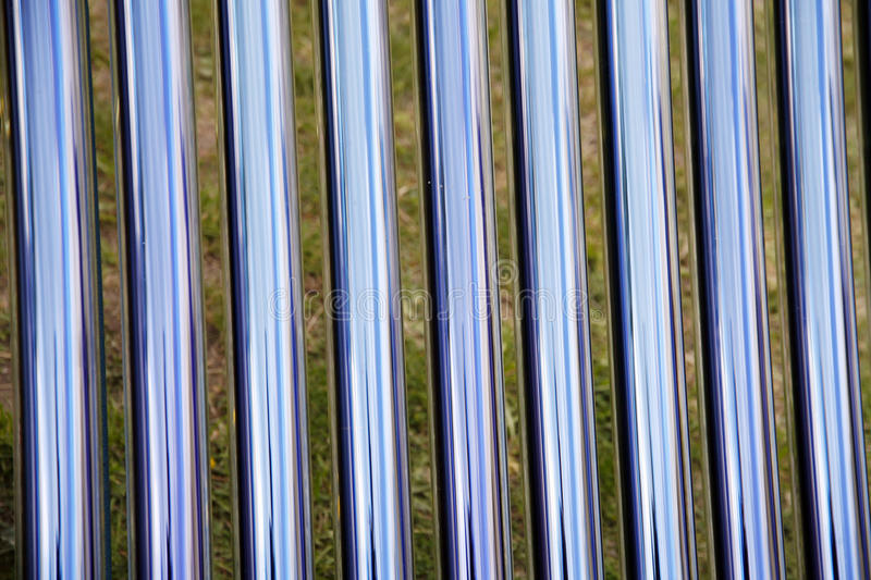 Details of evacuated tube solar collector. Tubes of a solar heating system. Elements of solar heating system royalty free stock photos
