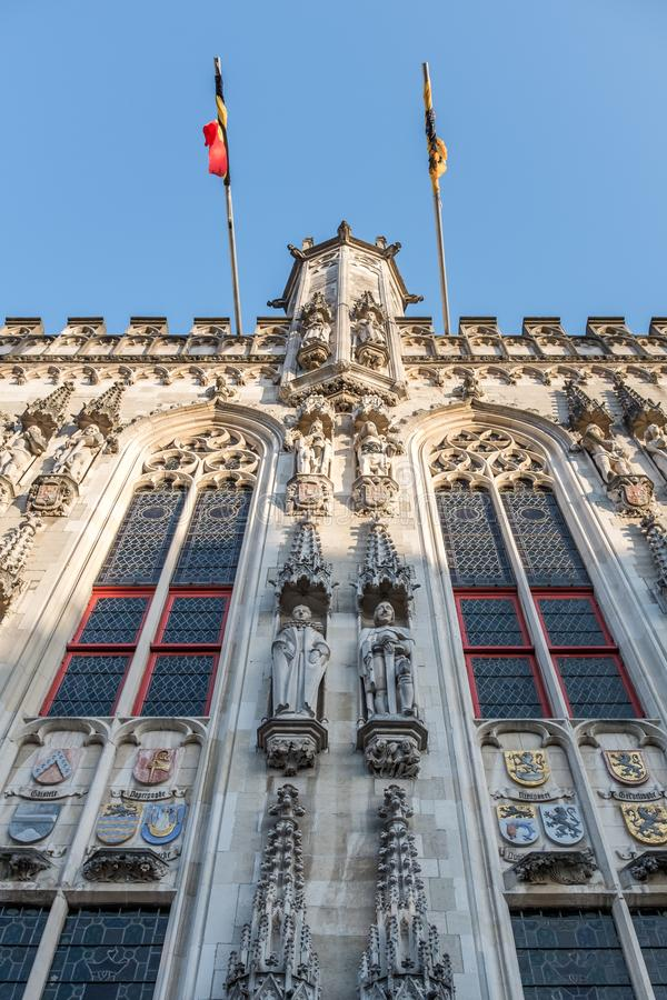 Facade of the town hall on `Burg` square in the center of the city of Bruges in Belgium. Details in facade of town hall on so-called `Burg` square in the center stock photography