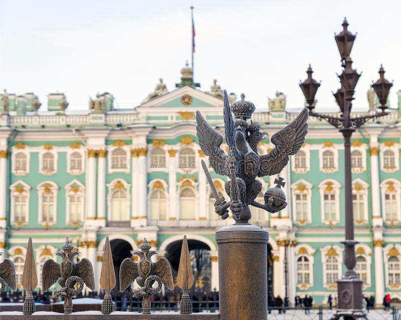Details fence decorations with the Russian imperial double-headed eagle symbol on Palace Square on the background royalty free stock photos
