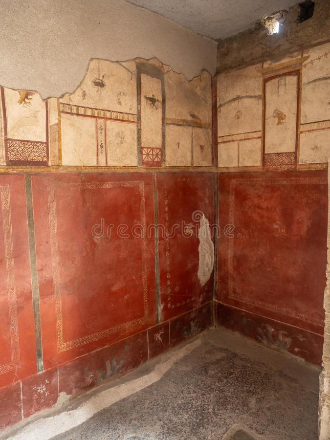 Roman frescos in Pompeii, Italy. World Heritage List. Details of frescos in rooms of ruined Roman villa in the ancient Roman city of Pompeii, near modern Naples royalty free stock image