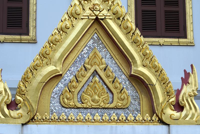 Details of The front gable of Wat Yannawa in Bangkok, Thailand, Asia. Details of The front gable of the landmark Buddis temple Wat Yannawa in Bangkok, Thailand royalty free stock photography