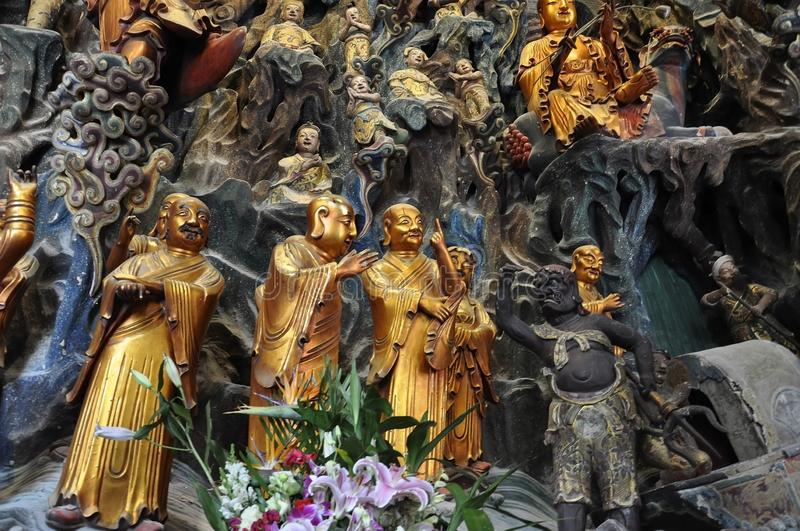 Golden Statue of Guanyin and Sudhana acompanied by their masters from the Jade Buddha Temple interior in Shanghai. Details from Golden Statue of Guanyin and royalty free stock photos