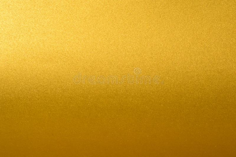 Details of golden texture background with gradient and shadow. Gold color paint wall. Luxury golden background and royalty free stock photos