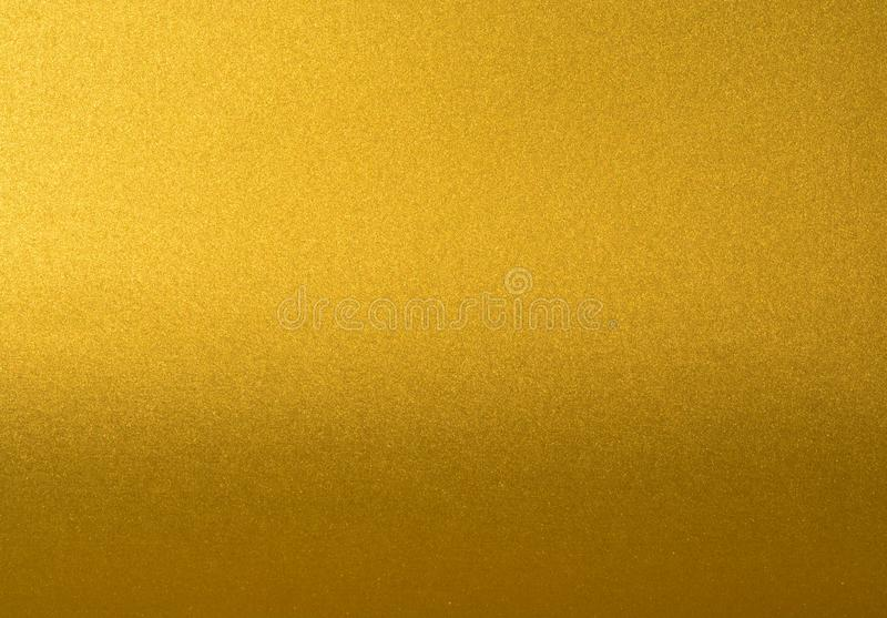 Details of golden texture background with gradient and shadow. Gold color paint wall. Luxury golden background and stock images
