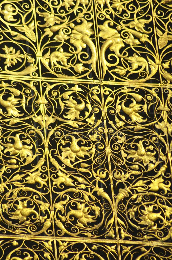 Details of goldwork on a decorative panel. royalty free stock photography