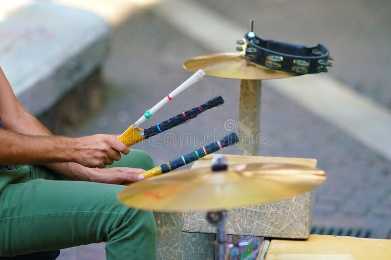 Details of the hands of a drummer making music in Ermou street stock images