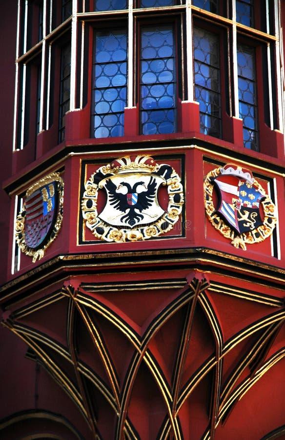 Details of Historical Merchants Hall facade, Freiburg im Breisgau, Germany. Amasing filigree balkony decoration of the Historical Merchants Hall Kaufhaus in royalty free stock photos