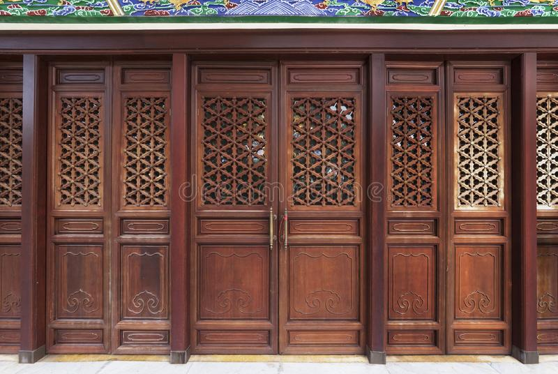 Wooden door of Chinese temple stock images