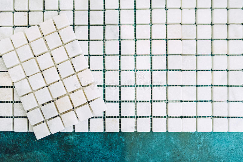 Details of home renovation - white marble decorative mosaic pattern ready to be applied on bathroom walls stock images