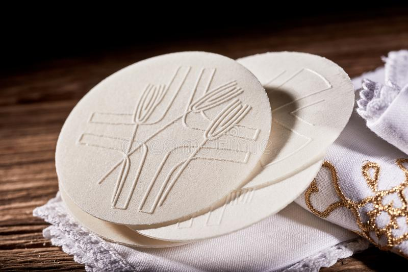 Details of the Hosties wafers or Sacramental Bread. Symbolising the body of the resurrected Christ used during Holy Communion in a church royalty free stock photo