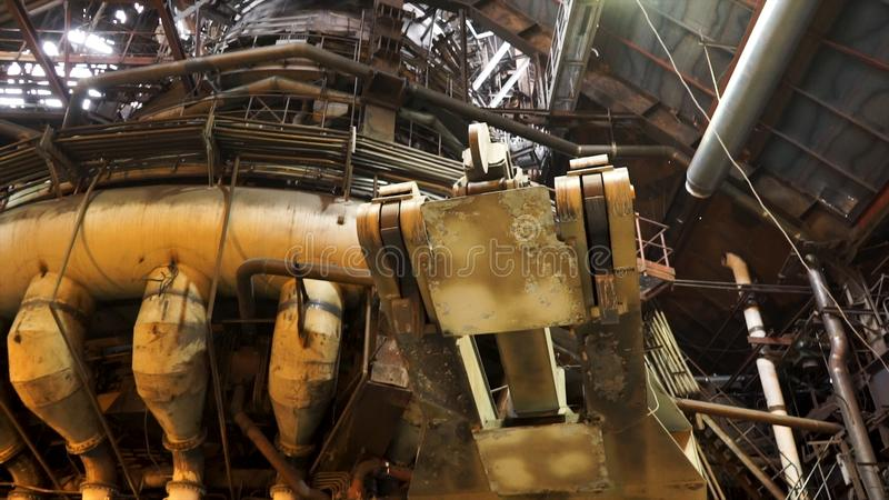 Details of the hot shop at the metallurgical factory, heavy industry concept. Stock footage. Bottom view of machines and. Details of the hot shop at the royalty free stock images