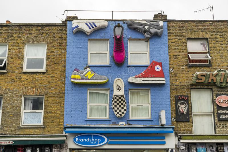 Details of house wall with shoes in Camden Town London England stock photos