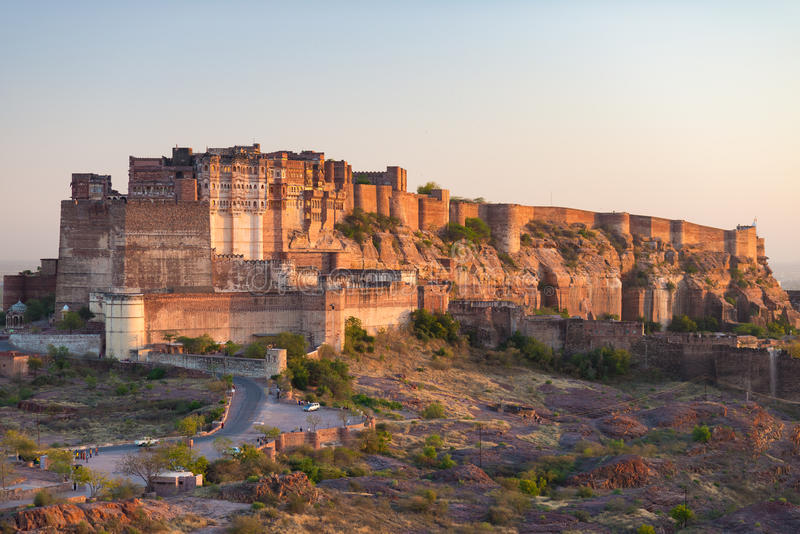 Details of Jodhpur fort at sunset. The majestic fort perched on top dominating the blue town. Scenic travel destination and famous. Tourist attraction in stock photography