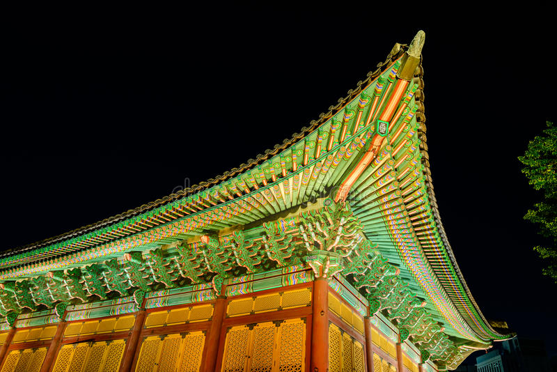 Details of Korean traditional roof. The gable roof of Deoksugung palace, Seoul, South Korea, at night time stock photography