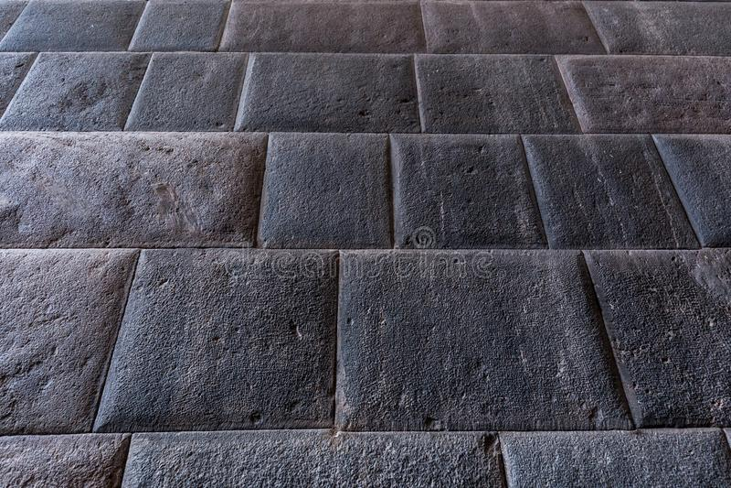 Details of masonry of Coricancha, famous temple in the Inca Empire at Cuzco, Peru. Inca stone wall in Coricancha, famous temple in the Inca Empire at Cuzco, Peru stock photos