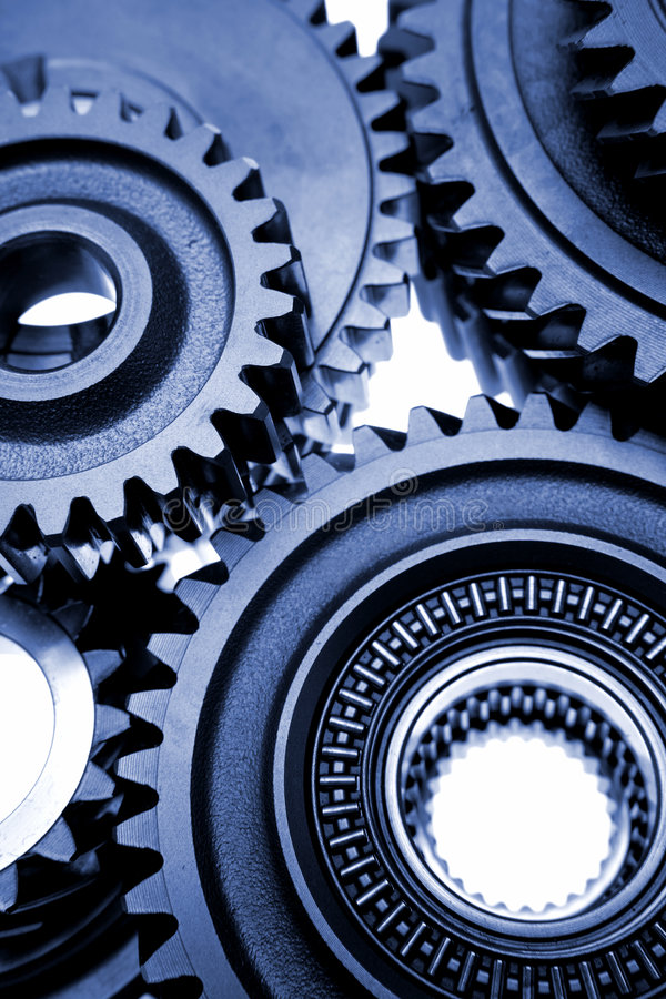 Details of mechanical gears. Details of large, mechanical gears on white background royalty free stock photos
