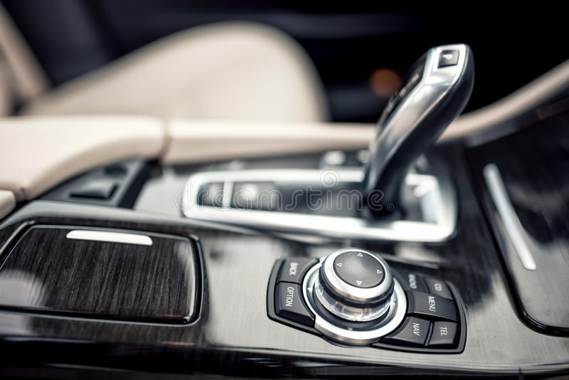 Details of minimalist design concept of modern car - close-up details of automatic transmission and gear stick stock photography