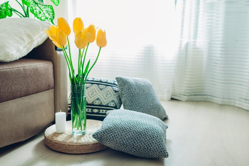 Details of modern living room interior. Tatami straw cushion decorated with flowers and pillow on the floor stock image